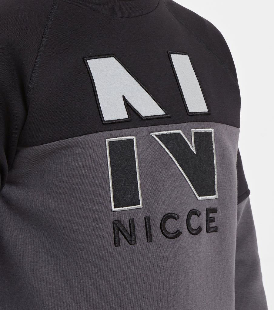 SPLIT N logo sweat in black. Featuring crew neck, long sleeves, two colour paneling in coal and black and embroidered 'N' chest logo. Pair with denim.