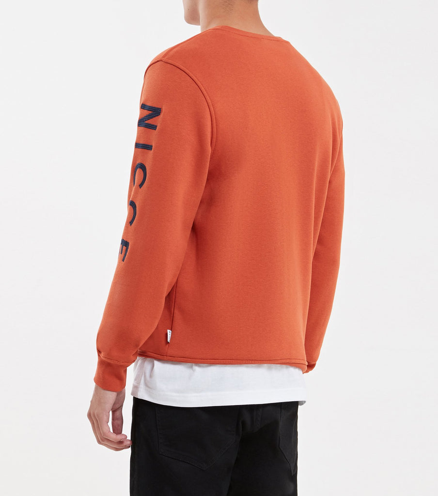 Radium sweatshirt in burnt orange. Features crew neck, long sleeves, with embroidered nicce logo's on both sleeves. Pair with joggers
