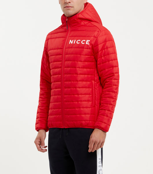 Aspen jacket in red. Features quilted design in a ripstop fabric, printed chest logo, full zip, hood and two side pockets. Pair with denim.