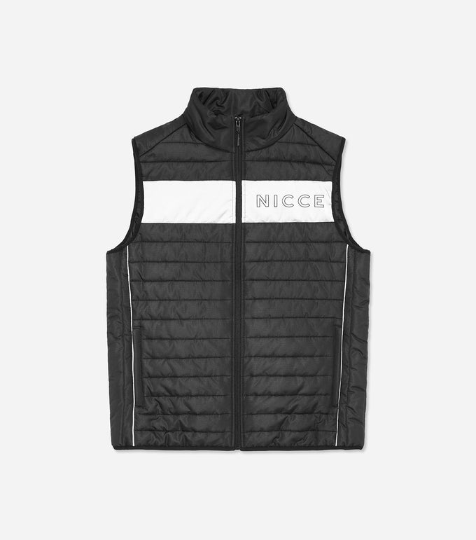 Monte gilet in black. Designed as a layering piece with extra padding to keep you warm and insulated. Features quilted fabric, black and reflective design, two side pockets, high neck, full zip, ripstop fabric, reflective panel with chest and back logo. Pair with joggers. *photo taken with flash