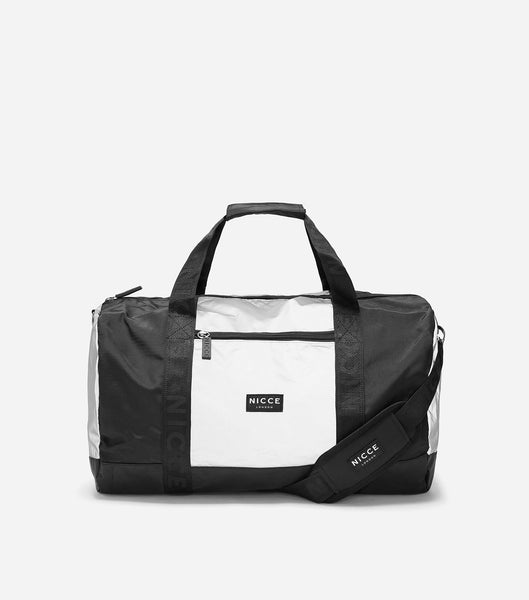 Barrel bag made of reflective material, featuring a front zipped pocket, NICCE woven logo, repeated logo lining, grab handle and detachable shoulder straps. Great for the weekend trips or the gym.