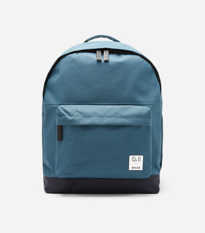Taro backpack in Majorca Blue featuring an external front zipped pocket, NICCE woven logo badge, repeated logo lining, padded adjustable straps, and a reinforced grab handle.