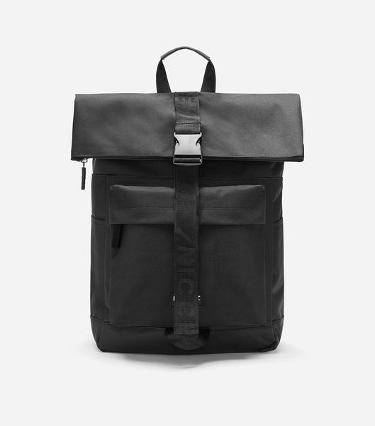 600D roll top backpack in black featuring a front zipped pocket, NICCE woven in label, padded adjustable straps, and a roll top with zip and clasp closure.