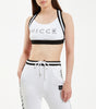 Swift sports bra in white. Features striped two colour elastic straps, lined for extra strength, backless design with cross over strap detailing and small keyline printed logo branding. Pair with NICCE Illusion joggers.