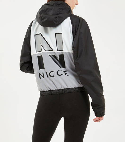 "Volley wind jacket in back. Features multi-colour panel detailing, large back heat-press ""N"" logo print, woven signature ""N"" badge, black rubberised logo puller, polyester cord at hem and hood and elasticated cuff and hem details. Pair with NICCE Rapid shorts."