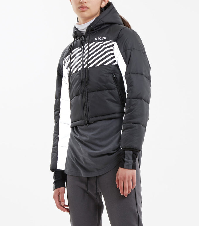 Flash crop puffa jacket in black. Features quilted fabric, hood, linear reflective print, under sleeve panelling in reflective material, zip pockets, front classic small heatpress reflective logo and black rubberised logo zip puller.