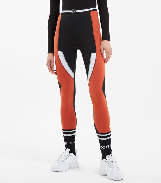 "Game leggings in black. Features contrast colour multi panels, high waisted fit, with sports flat lock seams, small print logo at hem, elasticated stripe colour tape at waist and ""N"" badge branding. Pair with NICCE Tidal sweat tee."