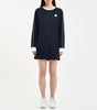 "Ennis long sleeve t-shirt dress in navy. Features sports pique fabric, sports flatlock contrast seam details at sleeve, contrast neck rib and white ""N"" woven badge logo. Pair with NICCE Volley wind jacket."