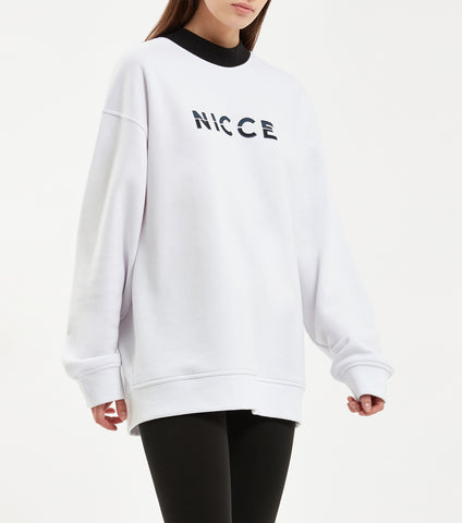 Slice sweat in white. Features oversize fit, contrast high neck rib and two colour raised split logo. Pair with NICCE princeton legging.