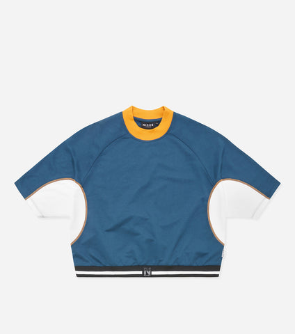 "Tidal sweat t-shirt in majorca blue and white. Features oversized batwing fit, contrast undersleeve panelling, contrast sport flatlock thread seam detailing, contrast high neck, knitted stripe waistband with black ""N"" badge branding. Pair with NICCE Game leggings."