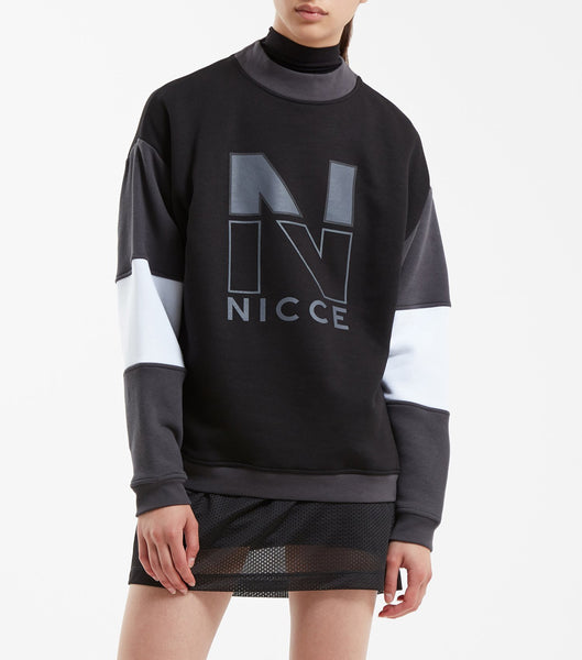 Mercer sweatshirt in black. Features high neck rib, oversized fit, triple colour panel sleeves and two colour raised rubber 'N' chest logo. Pair with quartz legging.