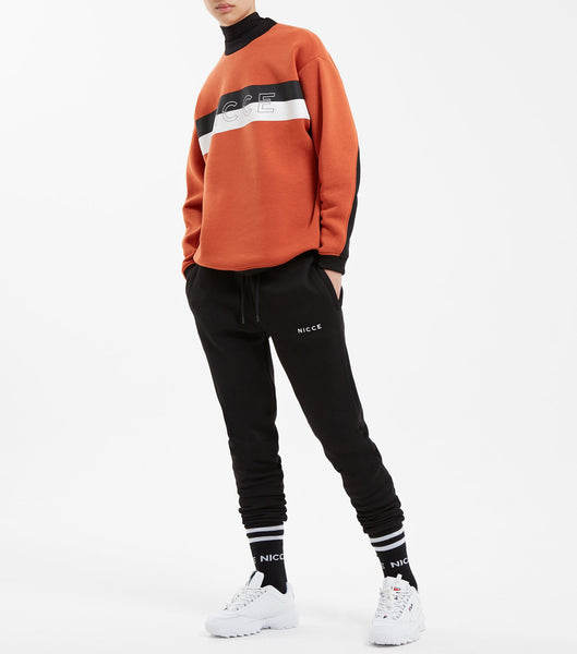 Combat sweat in burnt orange. Features contrast high neck rib, contrast panelled sleeves, chest keyline bar printed branding. Pair with streak jogger.