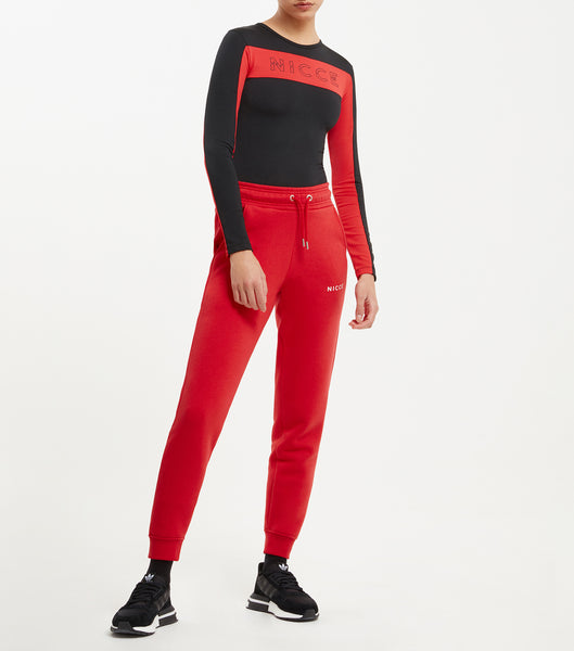 Combat bodysuit in back. Features long linear sleeves, body panelling in black and red, small split keyline chest logo, with back zip closure. Pair with joggers.