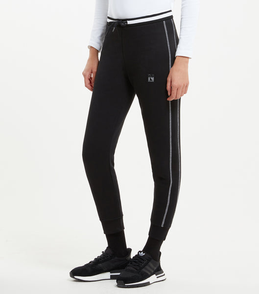 "Court jogger in black. Features cropped design with cuff finishing, side seam panelling with contrast flatlock stitching, stripe two colour rib waistband ith drawcord puller, single back pocket with side tab label, finished with a classic small woven ""N"" badge."
