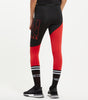 "Diagonal leggings in red and black. Features asymmetric diagonal cut panels, high waisted fit, split ""N"" keyline large logo, elasticated stripe colour tape at waist and ""N"" badge branding."