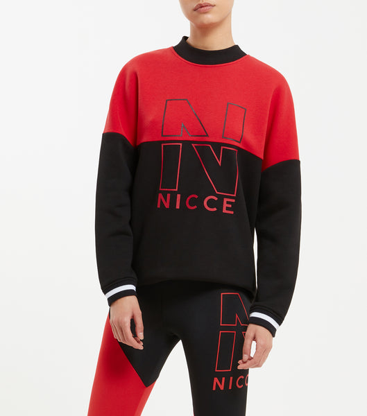 "Fraction sweat in red. Features oversized design, drop shoulder fit, horizontal panelling, contrast rib Crew Neck, two colour stripe rib cuff and waistband. Includes large dual """"N"""" printed logo, finished with a small woven label."