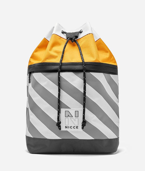 Blaze duffle bag in golden yellow. Featuring drawcord top, two colour panneling in yellow and stripe, shoulder straps, handle, NICCE 'N' badge branding,