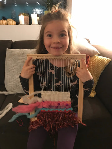little girl weaving