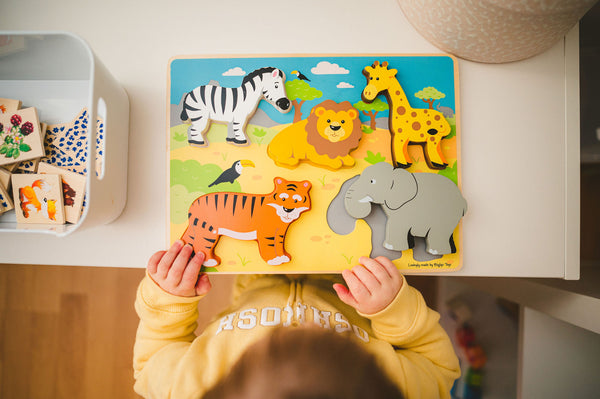 Toddler playing with wooden puzzle