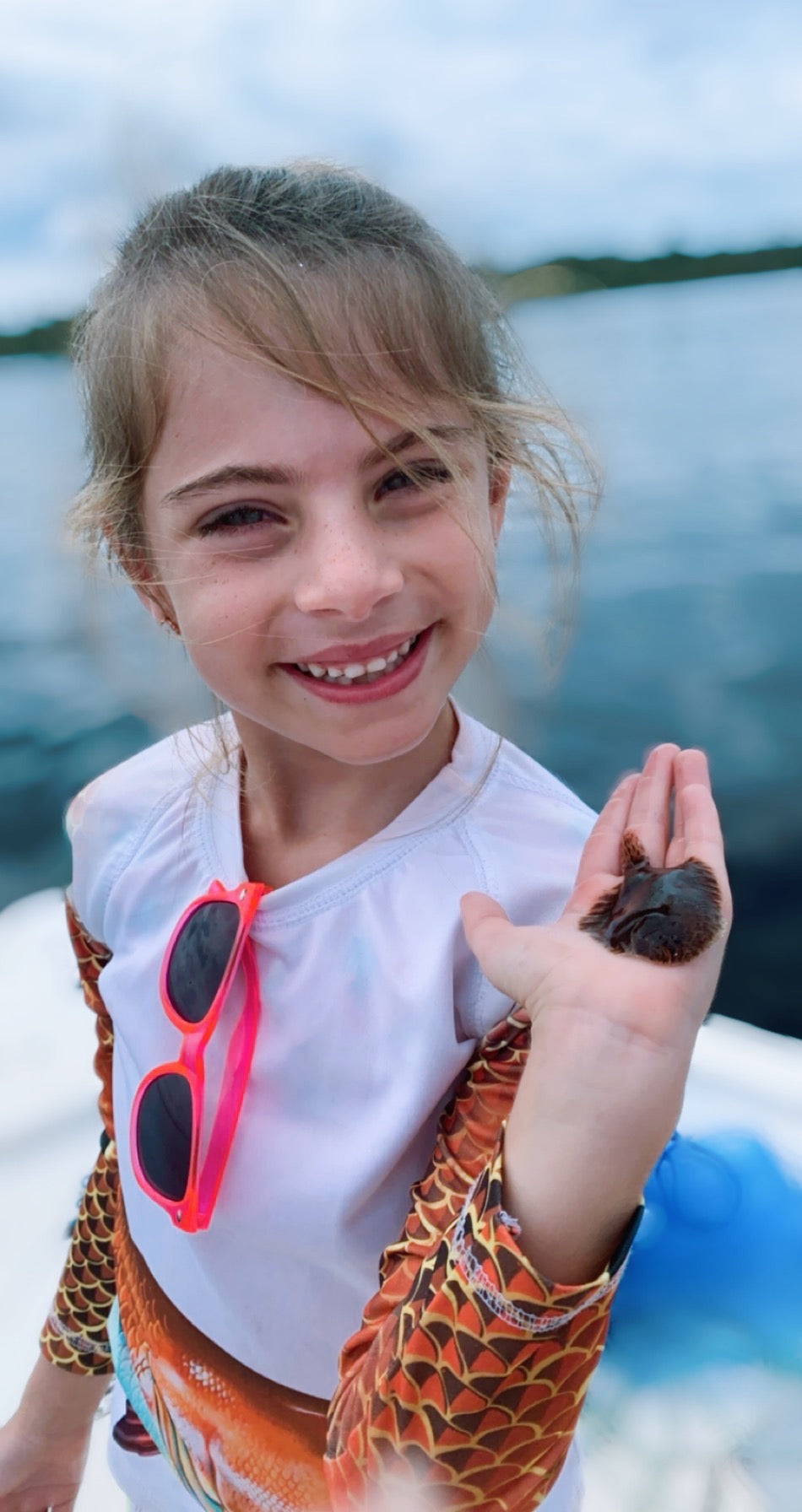 little girl holding a flounder fish. Little girl on a boat in the St. John's River in Palatka, Florida holding a flounder.