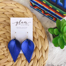Load image into Gallery viewer, Double sided metallic royal blue petal earrings made out of Faux leather with silver coloured hooks. From the Frida Collection.