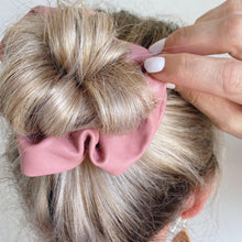 Load image into Gallery viewer, Dusty pink faux leather hair scrunchie around bun