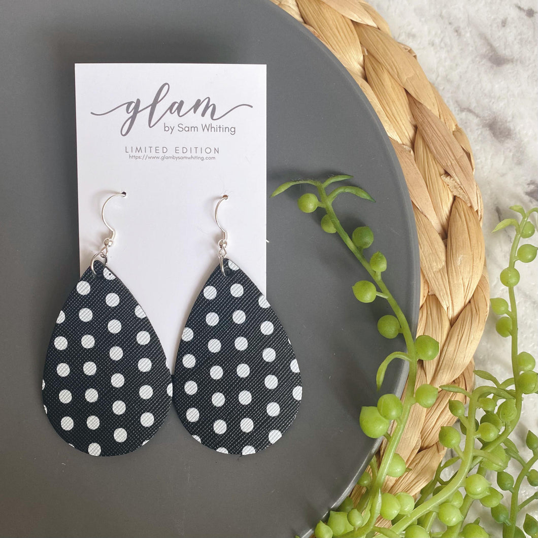 black and white polka dot faux leather earrings feathered leather earrings featuring a silver coloured hook