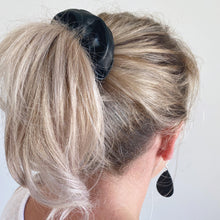 Load image into Gallery viewer, Black faux leather hair scrunchie in ponytail