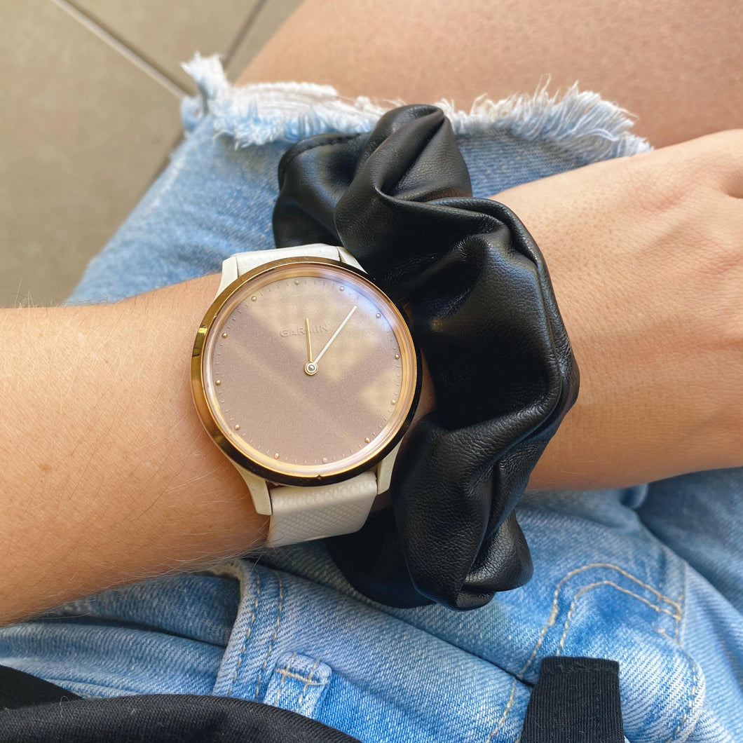 Black faux leather hair scrunchie on wrist