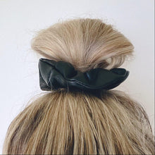 Load image into Gallery viewer, Black faux leather hair scrunchie in top knot