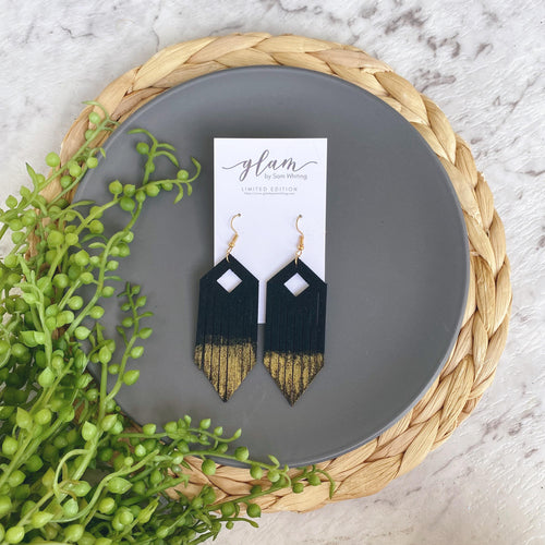 Gold tipped black fringe leather earring with gold coloured hook.