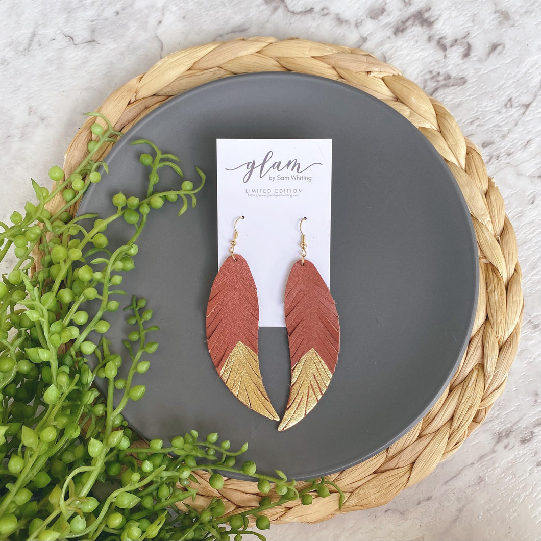 Gold dipped tan leaf leather earring with gold coloured hook.