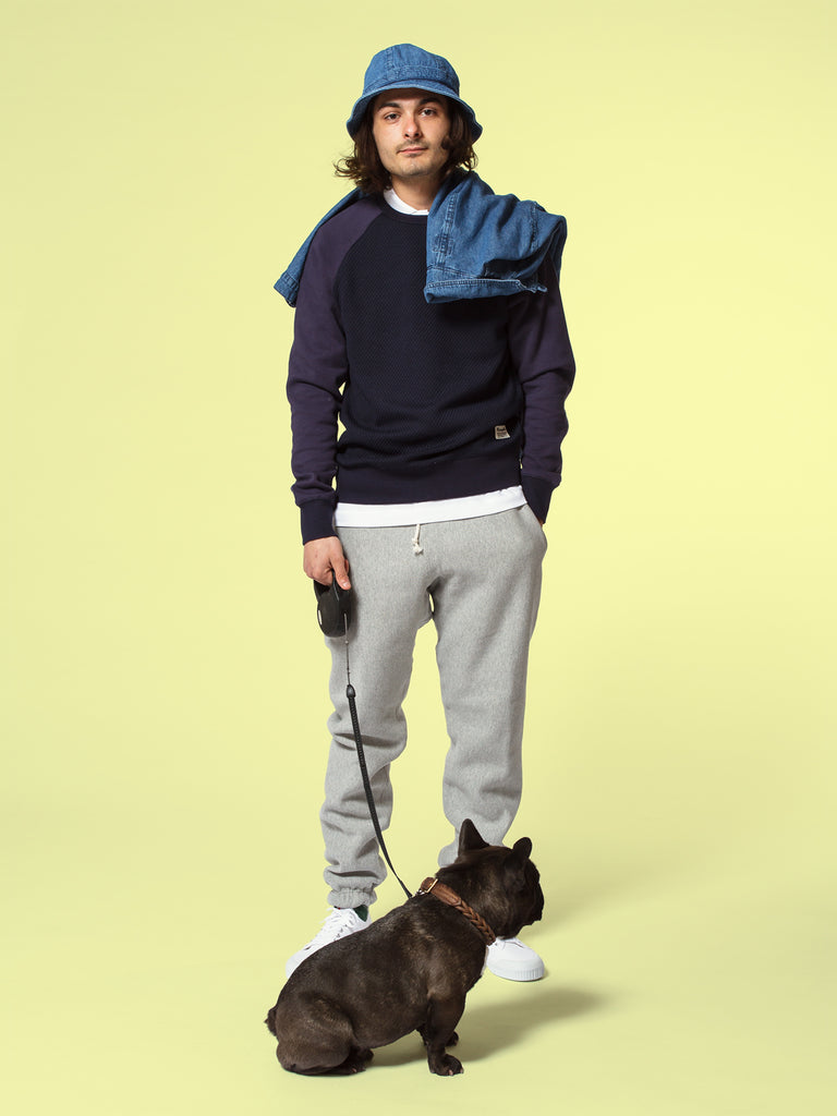 Picture of a man wearing French clothes with a French bulldog called Claude.