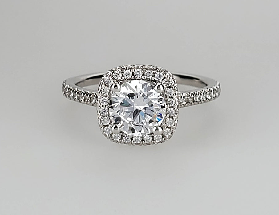 Double-sided halo with 76 diamonds with a straight diamond shank mounting