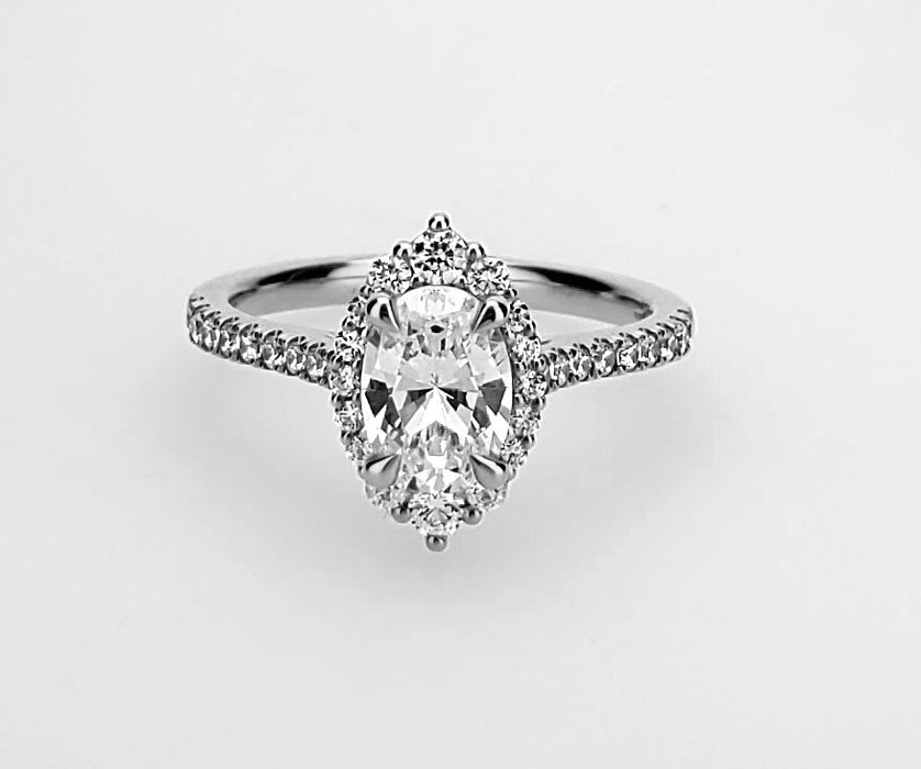 Graduated diamond halo ring with fancy wire cage head Mounting