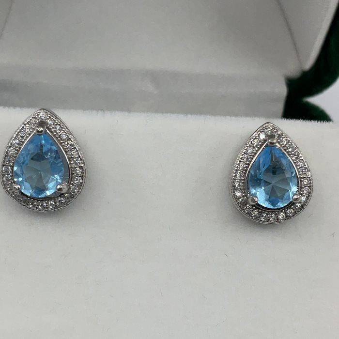 Sterling Silver Teardrop Simulated Blue Topaz with CZ Border Earrings