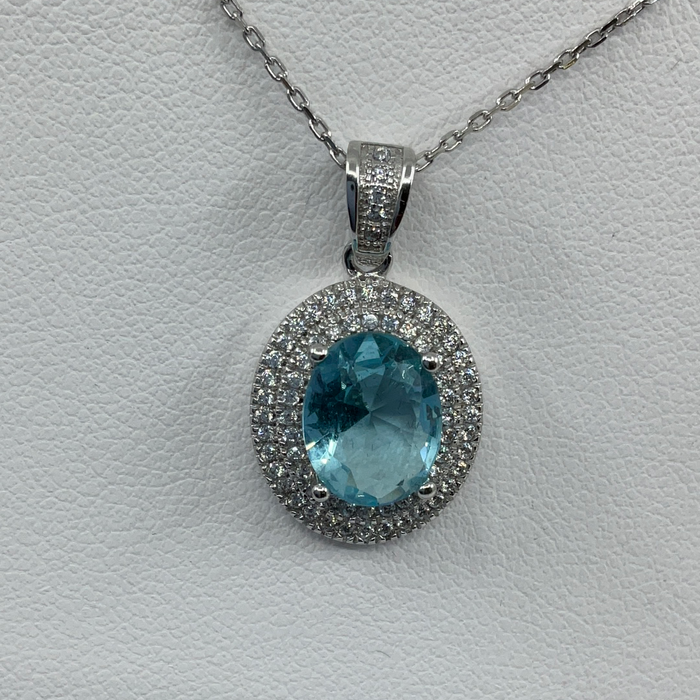 Sterling Silver Oval Simulated Blue Topaz with CZ Border Pendant