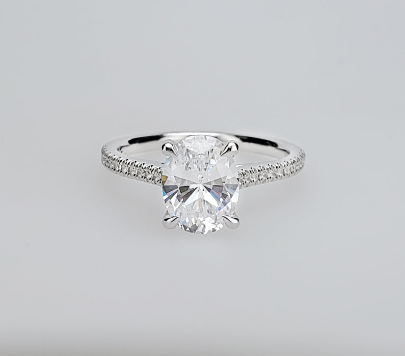 Delicate diamond shank cathedral engagement ring mounting with oval center