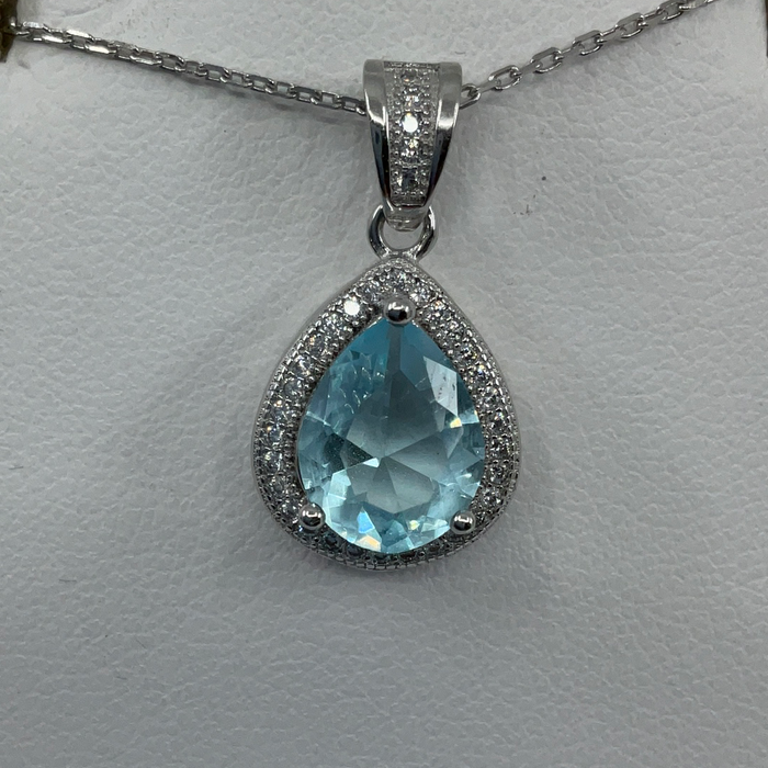 Sterling Silver Teardrop Simulated Blue Topaz with Cubic Zirconia Border Pendant