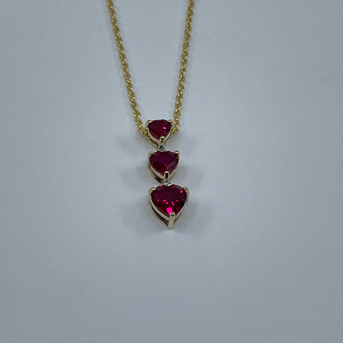 10KT Yellow Gold Synthetic 3 Heart Ruby Pendant