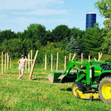 Installing posts in the next section of vineyard. Grape vines will be planted in spring. WINEaLOT Vineyards LLC