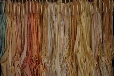 A Line of Undergarments on Hangers