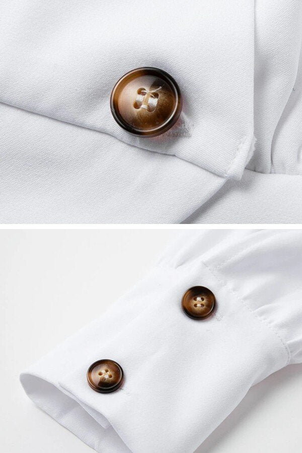 White blazer look-a-like top with brown buttons on the front and on the cuffs