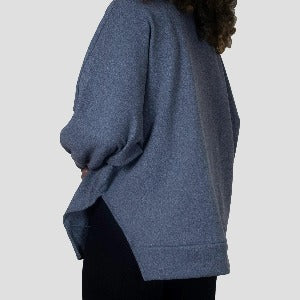Grey turtleneck pullover sweater, sides split open from the elbow down