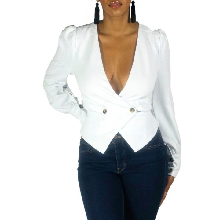 White blazer look-a-like top with brown buttons, and puff shoulder