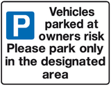 Vehicles parked at owners risk and park in designated bay | Parking sign