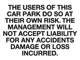 Car park at own risk sign