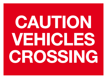 Caution vehicles crossing sign