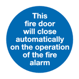 This fire door will close automatically on the operation of the fire alarm sign