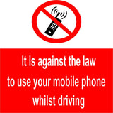 No mobile phones whilst driving sign